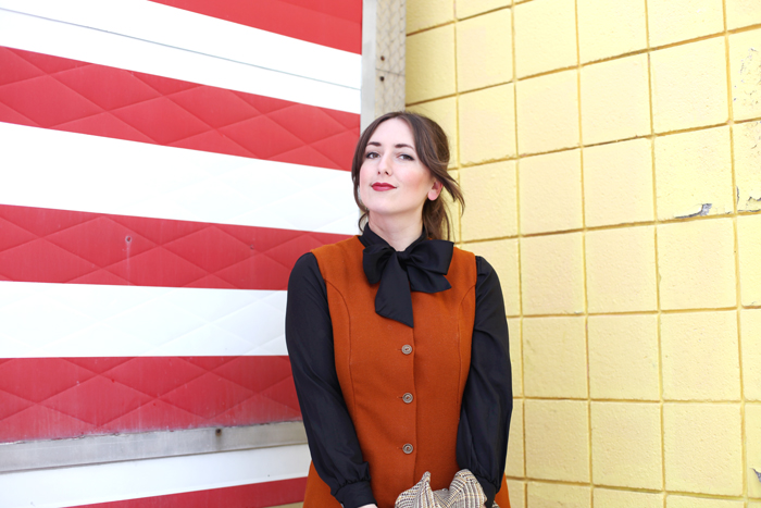 brown vintage jumper dress with black ascot blouse