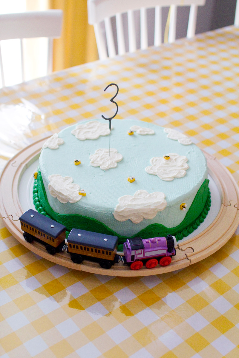 rolling green hills and blue sky birthday cake