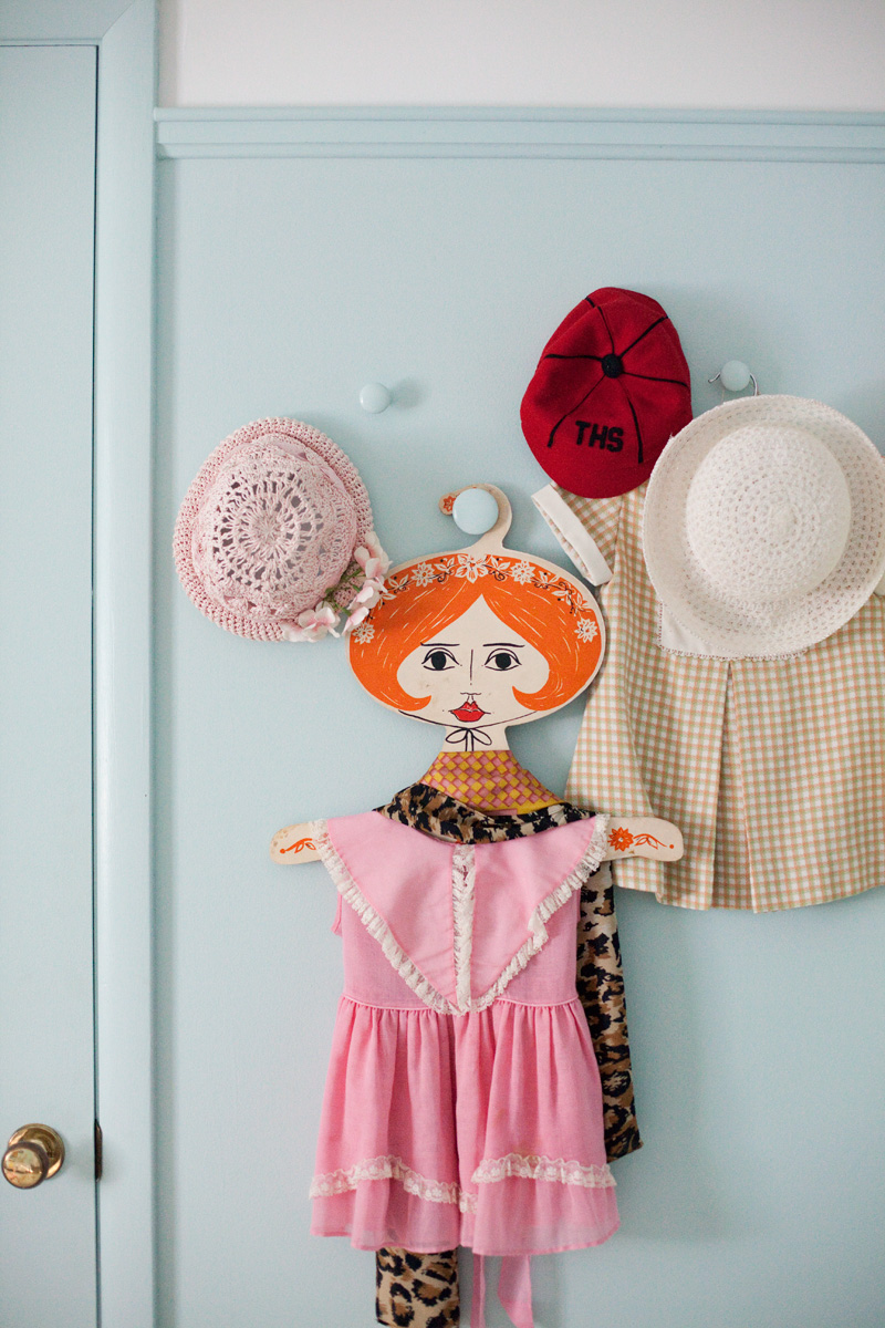 vintage clothing hangers with faces