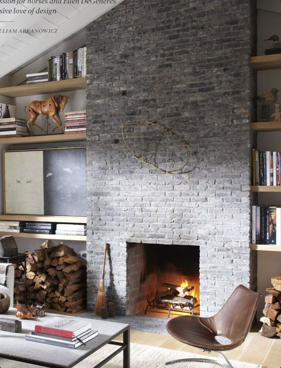 Floating shelving around floor to ceiling fireplace